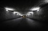 Empty dark tunnel at night