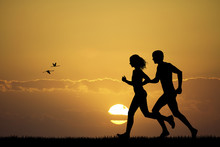 Girl And Boy Running At Sunset