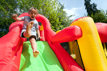 Child On Inflatable Bouncy Cas...