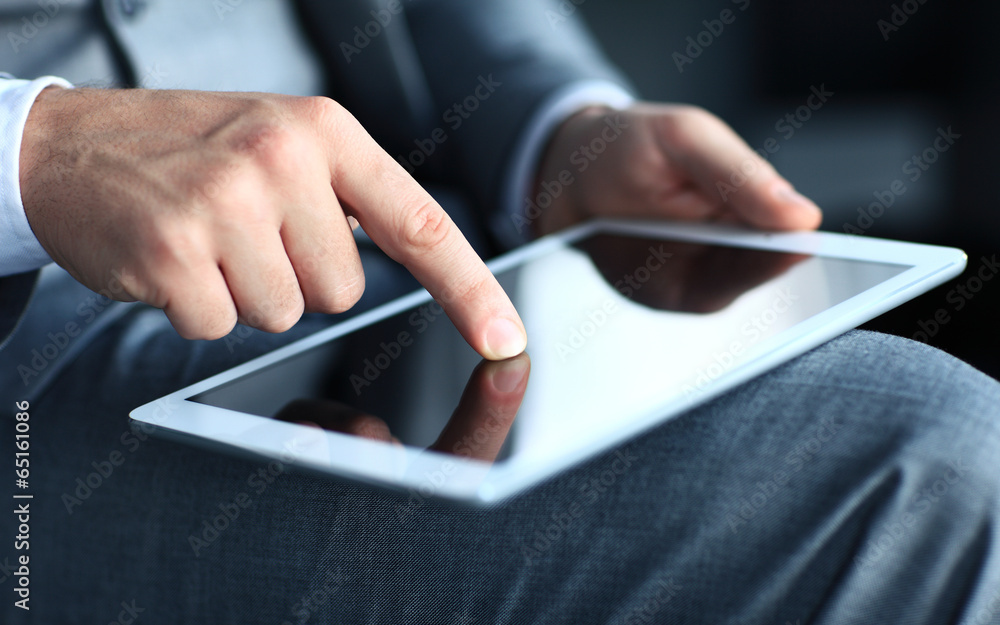 Fototapeta businessman touching screen of a tablet computer.  - obraz na płótnie