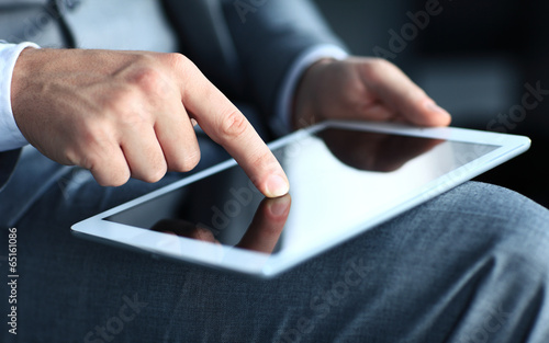 Fototapeta businessman touching screen of a tablet computer.  obraz na płótnie