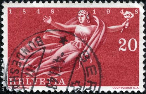 Fotografie, Obraz  stamp printed in Switzerland shown flying Helvetia with a torch
