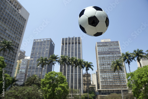 Football Flying in Sao Paulo Brazil City Skyline