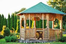 Outdoor Wooden Gazebo Over Summer Landscape Background