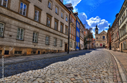 Poster Artistique Street of the old town in Warsaw. Street Mostowa