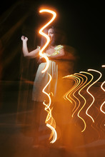 Cute Lady Having Fun In Summer Night With  Lightpainting