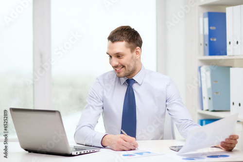 Garden Poster smiling businessman with laptop and documents