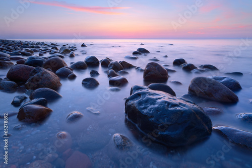 Keuken foto achterwand Purper Beautiful stones in the ocean. The Baltic Sea coast, Poland.