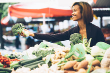 Young Woman Buying Vegetables ...