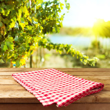 Empty Wooden Deck Table With Tablecloth