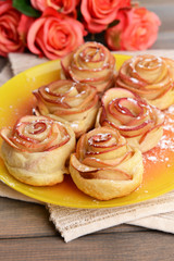 Obraz na płótnie Canvas Tasty puff pastry with apple shaped roses