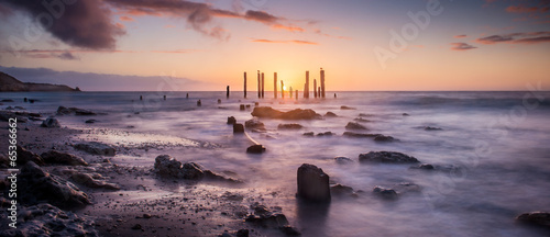 Sunset over jetty remains