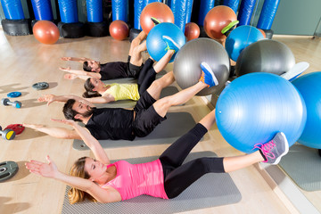 Fototapeta Do klubu fitness / siłowni Fitball crunch training group core fitness at gym