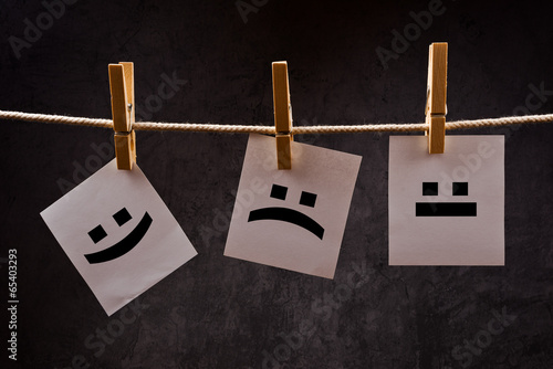 Fotografie, Tablou  Emoticons on note paper attched to rope with clothes pins