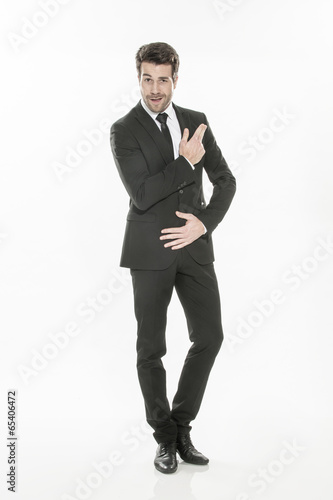 Foto  portrait of an expressive young man in suit on isolated backgrou