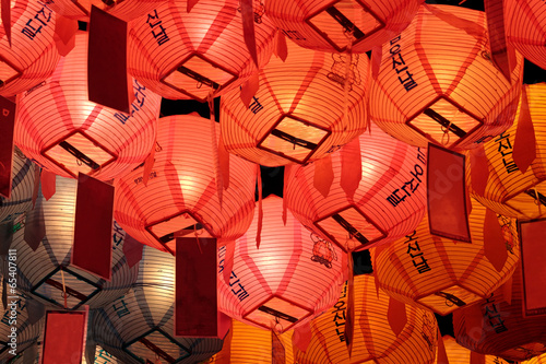Glowing red, pink and yellow lanterns in night