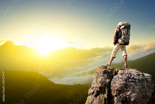 Fotografie, Obraz  Tourist on rock. Sport and active life concept