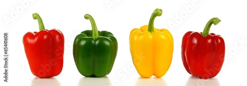 Canvas Print Row of a variety of bell peppers, red, green and yellow