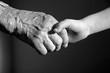 hand of grandmother and grandchild