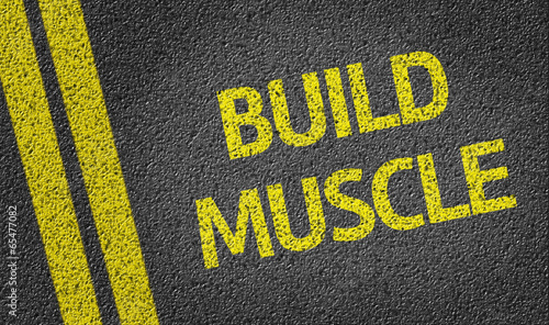 Build Muscle written on the road Canvas Print