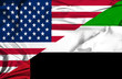 Waving flag of United Arab Emirates and USA