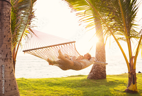 Couple relaxing in tropical hammock Canvas Print