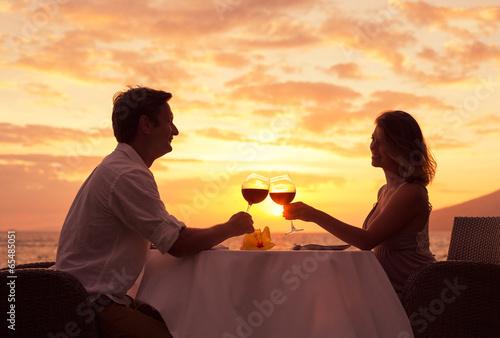 Couple enjoying romantic sunnset dinner