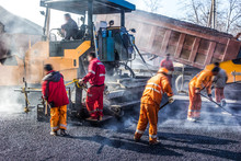 Workers Making Asphalt With Sh...