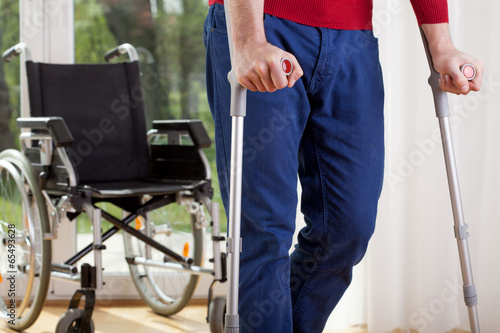 Foto Disabled man on crutches