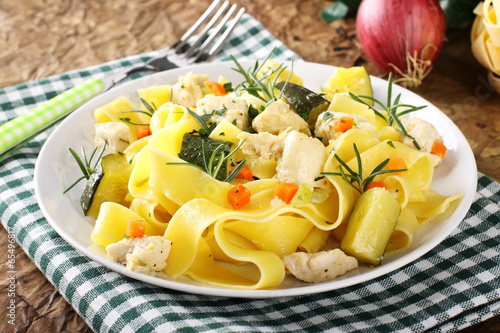 Photo  Pasta with fish, zucchini and carrots