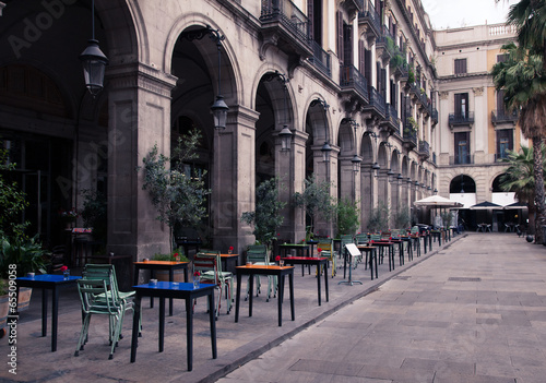 street cafe with colorful tables and chairs #65509058
