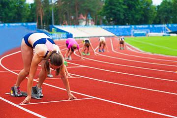 Fototapeta sportswomen at the start