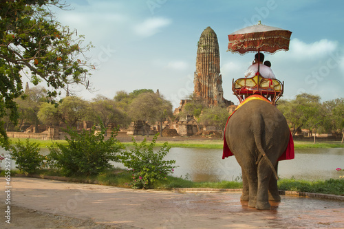Tourists on an elephant ride tour of the ancient city Ayutaya ,t