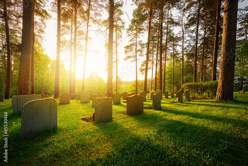 Foto auf AluDibond Friedhof Graveyard in sunset with warm light
