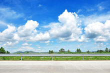 Beautiful Roadside View With Green Nature And Cloudy Blue Sky  B