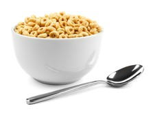 Bowl Of Oat Cereal With Spoon On White Background