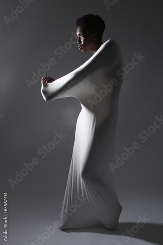 Shapely Woman in Creative Light and Spandex Fabric Fototapeta