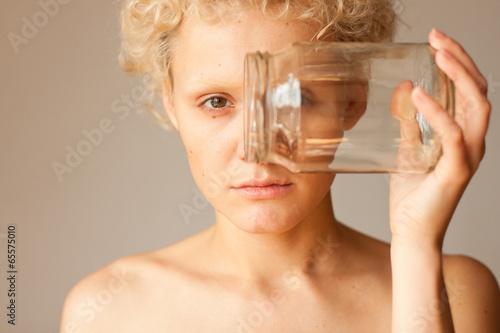 Abstract picture - the girl looks through the empty jar. Tapéta, Fotótapéta