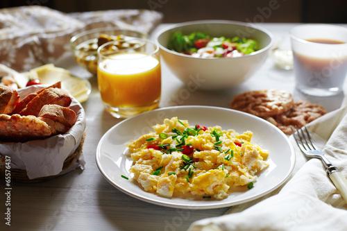 Fototapeta Fresh breakfast food. Scrambled eggs and orange juice. obraz