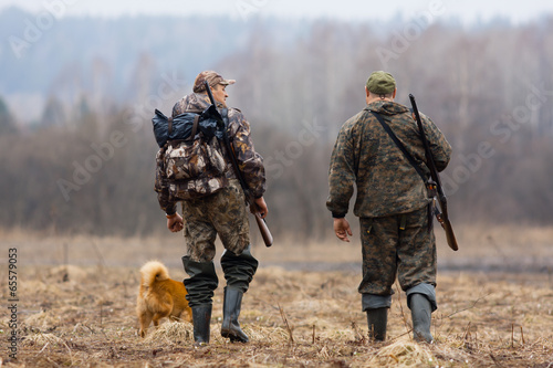 Fotobehang Jacht two hunters and dog