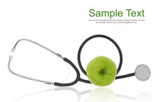Stethoscope With Green Apple Isolated On White