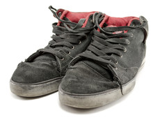 A Pair Of Old Sneakers Isolate...