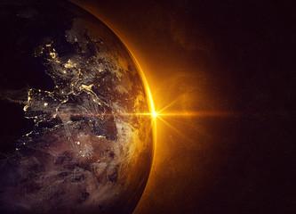 Fototapeta wschód słońca w kosmosie