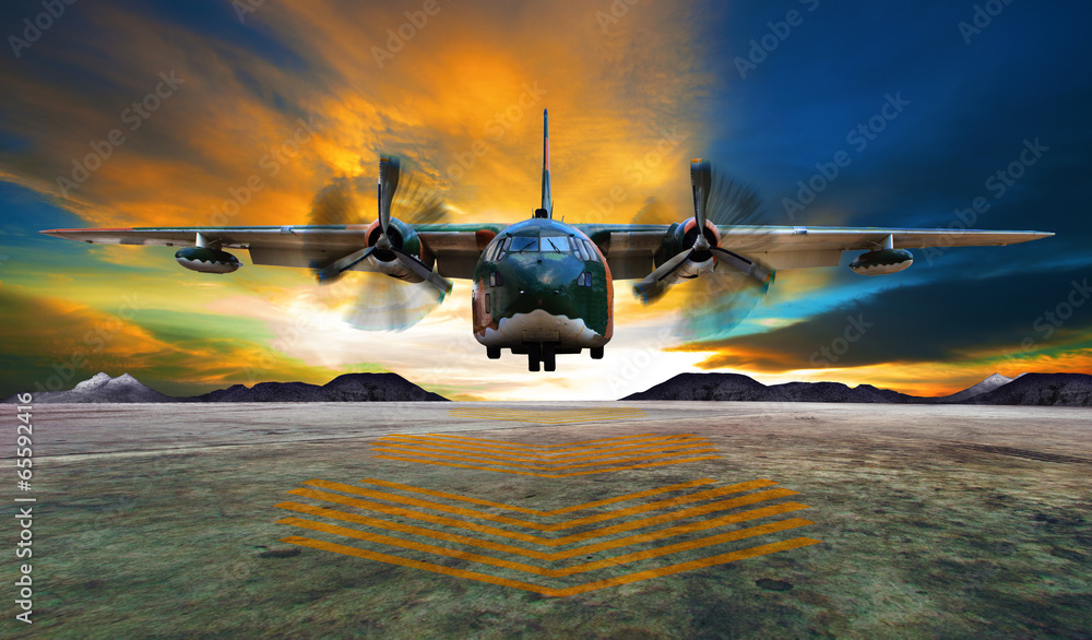 Fototapeta military plane landing on airforce runways against beautiful dus