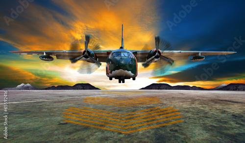 duzy-wojskowy-samolot-ladujacy-o-zachodzie-slonca