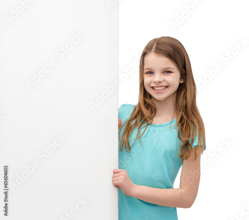 happy little girl with blank white board