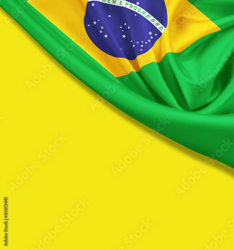 Fotografia  Flag of Brazil on yellow background. Clipping path for flag is i