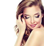 Sweet smiling girl holding her hair