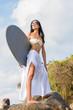 Asian model hodilng a surfboard