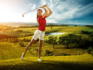 Fototapeta Golf Woman golfer hitting the ball on the scenery beautiful